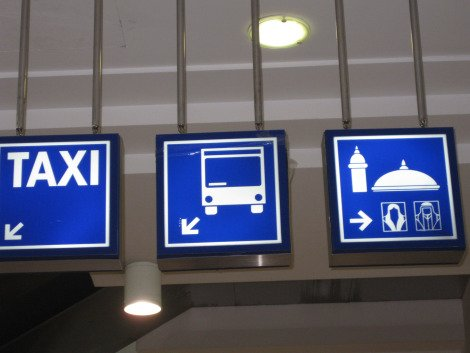 Signs at Doha City Centre. Taxi, bus and male & female mosque