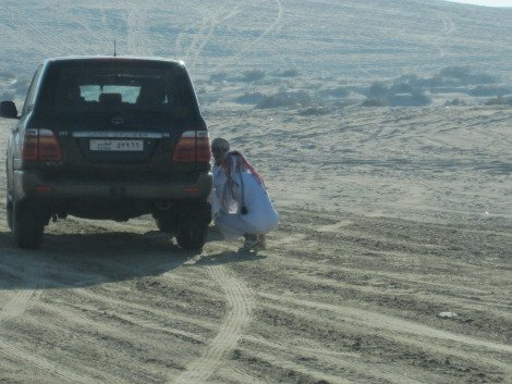 Dropping tire pressure before hitting the dunes.