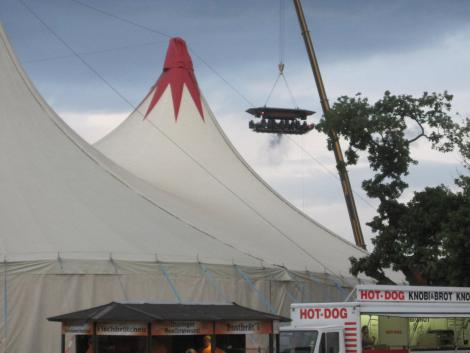 A bar suspended by crane above the second stage tent.