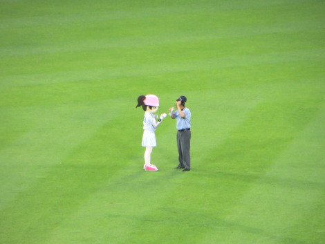 Mascot brining the umpire water between innings. Baseball in Korea