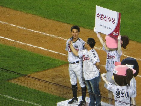 Man of the match is presented to the crowd Baseball in Korea