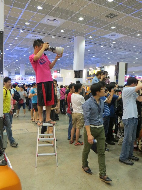 Why fight for position when you can just bring a step ladder to see the Seoul Auto Salon girls