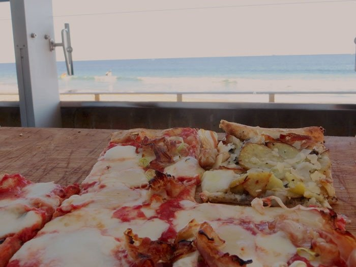 Pizza comes with a complimentary beachfront view. Wollongong Weekender