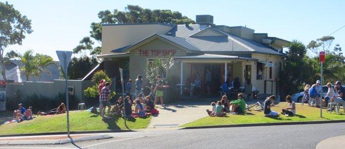Top Shop Byron Bay - people eating on grass Australian East Coast Road Tri