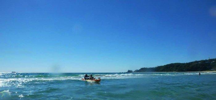 Surfing to shore Byron Bay Sea Kayak Australian East Coast Road Trip