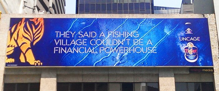Tiger Beer ad in Raffles Place. Says it all