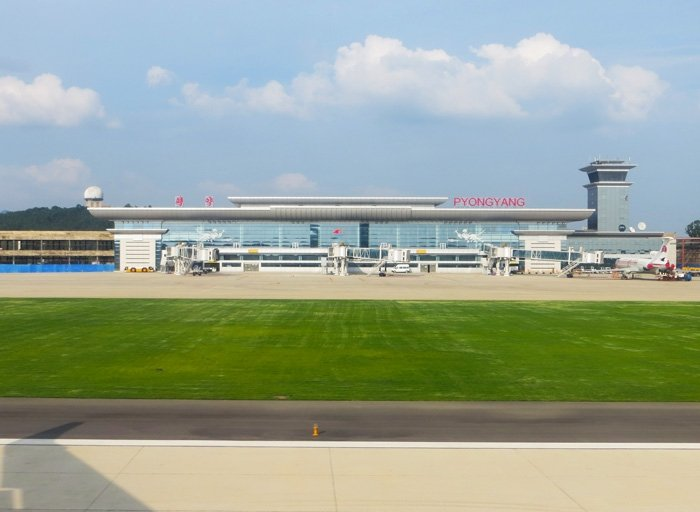 The brand new Pyongyang Airport. I wasn't kidding about the grass