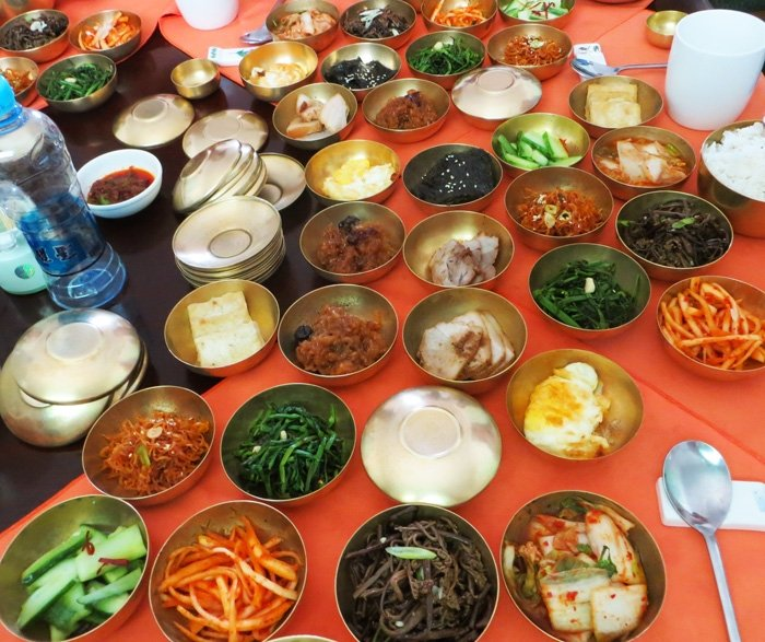 11 golden bowls of Banchan dishes
