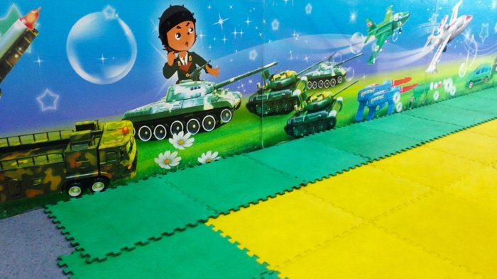 Mural featuring child in tank